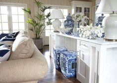 Ethan Allen A blue and white palette with a collection of blue and white Chinese porcelain in this sophisticated great room.