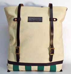 """Hand dyed cotton canvas Street/Motorcycle backpack - natural colored with palm green stripe and black leather strap ● Size: 5,5"""" x 14,2"""" x 17,3"""" - American ● 14 cm x 36 cm x 44 cm - European ● In case of order, please contact us with the following e-mail address: info@smithandscribeco.com #backpack #1920's #1930's #1940's #cottoncanvas #handpaintedcanvas #copperrivet #italianleather #handmadeineurope Motorcycle Backpacks, Hand Painted Canvas, Scribe, Green Stripes, Bradley Mountain, Italian Leather, Cotton Canvas, Palm, Black Leather"""