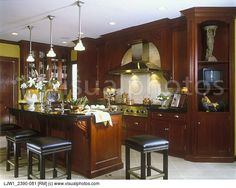 KITCHENS - View of cherry and granite island with lots of curves, eating area, wood and tile flooring, decoration columns. Description from visualphotos.com. I searched for this on bing.com/images