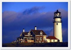 Cottages and light house on the beach, south Yarmouth, Cape Cod. USA