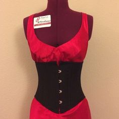 """Black Cashmere Waist Cincher Waspie styled waist cincher works to flatten the stomach and give you the hourglass shape you've always wanted. Designed for tight lacing, it fits comfortably, and works effectively for waist training. Size 22"""" OR 26in-24in natural waist. Timeless Trends  Tops"""