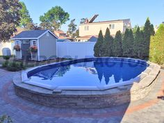 Landscaping around your semi inground pool with brick creates a uniform look to your backyard. #thepoolfactory