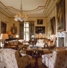 The walls of the drawing room are covered in gilt-framed portraits