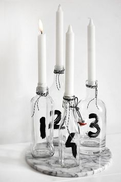 hand painted table numbers on clear glass bottles
