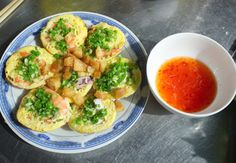 Căn cake - a specialty from Phan Thiết city. Made from rice flour, topped with mince of shrimp & green onion. Yummy!