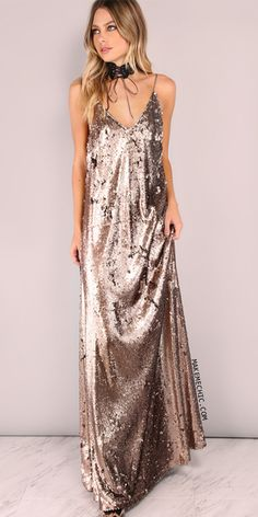 Get a high fashion vibe with the Sequin Cami Maxi Dress! Features sequin upper, spaghetti straps, and a backless design. Stand out from the crowd by styling it with a chic choker, faux fur coat and a pair of killer heels.