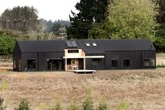 WINNER: Tane Cox's Modern Barn Form built in Whatawhata, Waikato, took out the supreme award at this year's ADNZ Architectural Design Awards. Red Architecture, New Zealand Architecture, Modern Barn House, Barn House Plans, Barn Plans, Norton House, House Cladding, Steel Barns, Black Barn