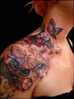 See more Colorful butterflies tattoos on neck and shoulder
