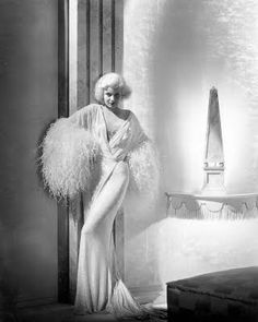 Jean Marlow in Dinner at Eight. Jean is iconic as the spoilt, classless gold digger in this Thirties movie. She had so much life as an actress, and this outfit was the perfect mix of glamorous and over-the-top living perfect for the film.