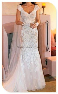 lace wedding dress. Love the sleeves. Even better if it had more of a dropped waist than the trumpet thing going on...