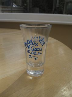 Personalised shot glasses ready to be filled with homemade blackberry wedding vodka