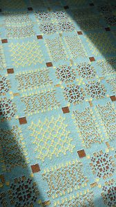 Vintage Melin Tregwynt Welsh tapestry blanket in pale blue, brown and yellow