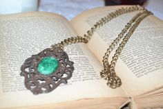 Antiqued copper with green cameo necklace. Simple boho