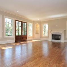 Love all the windows and natural light with this very light shade of beige. Sherwin Williams Accessible Beige. Love love love the hardwood floors