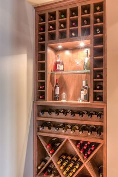 Contemporary Wine Cellar with Built-in bookshelf, High ceiling