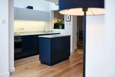 Modern kitchen with dark cabinets and white wash walls https://www.bathbespoke.co.uk/kitchens/