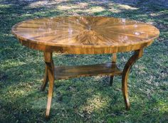 Artisan Furniture & Cabinetry   Oval Entry Table in Claro Walnut. High polished patterned top.