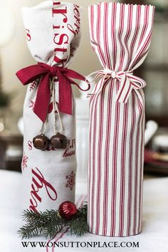 Hostess Gift Ideas: wrap a wine bottle in a festive tea towel. This post has the link that shows you how to fold the towel.