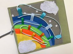 This page can be ordered separately or as part of a quiet book or mini quiet book. For a whole quiet book you should choose 6 pages. The mini busy book contains 3 pages as you wished. This page is about stringing the line across the rainbow with two cloud pockets. You can choose colors in