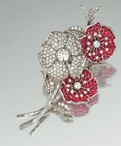 RUBY AND DIAMOND FLOWER BROOCH, MONTURE BOUCHERON, CIRCA 1950