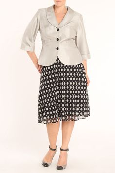 Dana Kay Plus Michelle.  Like the structure to the blazer, and the skirt line, but it's sdlkjsfdf dots again.