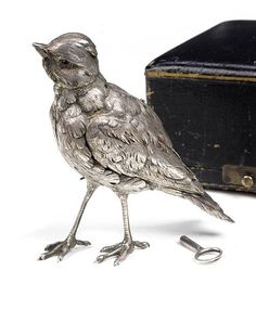 Silver standing and singing bird automaton, c. 1880, with original box and key