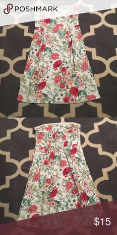 Old Navy Strapless Floral Dress Size 8 Size 8. Excellent condition. Two pleats on front to give it shaping. Easy to dress up with heels or down with a jean jacket.  White with pink and green Floral print. Elastic back for perfect fit and grip band in top of bodice to keep it up. Length is 30 inches. Waist measures approximately 14 1/2 inches lying flat. I have 2 more like this one listed in different prints. Check out my closet to bundle. Old Navy Dresses Midi