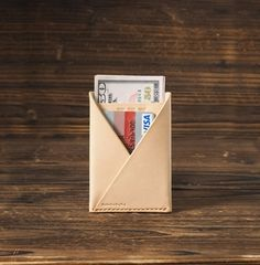 """The Card Wallet is constructed out of two single piece of vegetable tanned leather. Two-pocket card holder. For those that carry multiple cards and some cash. It features one pocket for cash and one slot for cards.  Material: - Vegetable tanned leather (1.6 - 2.0 mm thickness) - Wax thread  Size: - 113 mm (H) x 80 mm (W) - 4.45 """" (H) x 3.15 """" (W)  Details: - 100% handcrafted, made to order - Color: Nude  -------------------------------..."""
