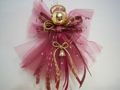 Heavenly and Etherial Burgandy Tulle Angel Christmas Ornament. $4.50, via Etsy.