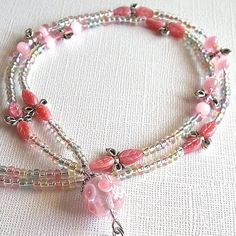 I made this one and sold it quite some time ago.  It was one of my favorites. Beaded Lanyard: Pink Lampwork, German Pink Glass Leaves, Silver Bows