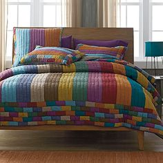 Stunning patchwork quilt with bold, yarn-dyed stripes in a variety of sophisticated colors. Hand-quilted of pure cotton and pre-washed for softness.