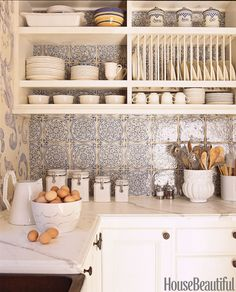 Above the countertops and stove of this California kitchen by designer Erin Martin, the backsplash is clad in a romantic blue-and-white French tile from Country Floors. 50 Inspiring Ideas to Update Your Kitchen