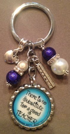"""This listing is for one """"There's No Substitute For A Good Teacher"""" bottle cap key chain.  This key chain makes a great gift for any teacher. It is embellished with blue and pearl like beads, a ruler charm and an apple charm.  Thanks for looking and have a great day!!  Laura"""