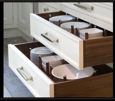 """Example of dishes stored in drawers. Definitely an option in your kitchen, rather than uppers. See also, dishes in """"pantry""""."""