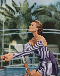 May Vogue 1954    Long sleeves and a big cotton obi sash, new coverage for the swimming tube. The fabric; a knitted combination of cotton and Lastex, by Polly Hornburg.