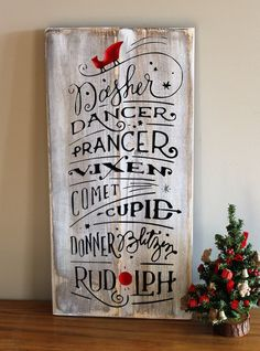 Add a touch of charm to your home with this sign. All of the reindeer names: Dasher, Dancer, Prancer, Vixen, Comet, Cupid, Donner, Blitzin and Rudolph. Carved lettering painted black, carved sleigh and Rudolph nose painted red on a distressed white background. Made from solid wood. Measures 1 inches wide by 22 inches long. Comes with hanging hardware attached to back.