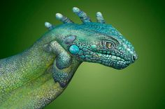 Hands painted to look like a cameleon.