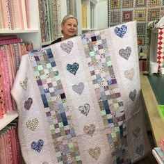 Sweetest lilac love hearts made by gorgeous Donna Campbell for her lucky grand daughter - I spy her cute grandson Hayden looking on with a watchful eye to make sure his big sister receives this divine quilt . . . . . . . #quilt #loveheart #lovehearts #madewithlove #handmade #handsewn #lilac #patchwork #quilting #checks #squares #stripes #sopretty #luckygirl #grandmalove #sew #sewing #family