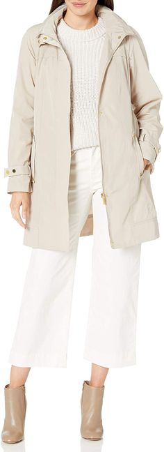 This Calvin Klein raincoat is made of polyester, making it machine washable (bonus!) and waterproof. It has adjustable cuffs with a stand-up collar, hideaway hood, and two slash pockets. Take a look at these stylish and Insta-friendly water-resistant jackets and share with us which raincoats you love the most! #TravelFashionGirl #TravelFashion #TravelClothing #capsulewardrobe #raincoatforwomen #fashionraincoat #raincoatoutfits Travel Raincoat, Anorak Jacket, Parka, Packable Jacket, Raincoats For Women, Calvin Klein Women, How To Roll Sleeves, Capsule Wardrobe, Cuffs