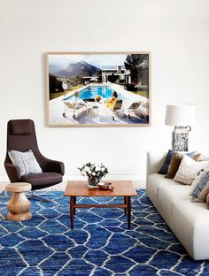 A Midcentury Moment. Modern living room with cobalt blue rug.