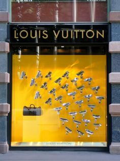 "Louis Vuitton did a great job symbolizing designer brands with this window display. Angling about 20 security cameras at a Louis bag, this window display symbolizes the idea of ""all eyes on me"" when wearing the brand. Window Display Design, Store Window Displays, Retail Displays, Visual Merchandising Displays, Visual Display, Display Shop, Bag Display, Vitrine Design, Pattern Texture"