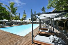This peaceful haven with its offbeat style and vintage decoration is the ideal place to relax and enjoy the surrounding nature. Sip a cocktail at sunset and relax on one of the hammocks in the roof top bar with a wonderful view of the bay. Enjoy Mauritian snacks whenever you want during the day or surf on the best waves of Mauritius.