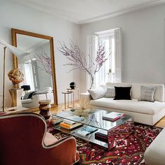 Eclectic living room design with bohemian style featuring pale gray walls, a large gold framed mirror, antique rug, and modern beige sofa - Living Room Ideas & Decor Eclectic Living Room, Home Living Room, Apartment Living, Living Room Designs, Living Room Furniture, Living Room Decor, Living Spaces, Madrid Apartment, Furniture Makers