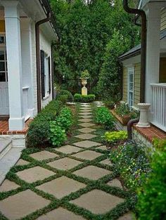 Inexpensive concrete squares set on the diagonal, changes a budget idea to elegance.  Would you do this? I'm liking this idea for the side yard!