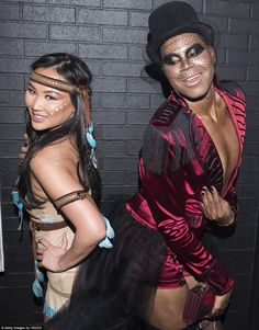 TV personalities Dorothy Wang, dressed as a native American, and E.J. Johnson, dressed as a ringmaster, attend VO|CO Presents Alessandra Ambrosio's Heaven And Hell Halloween Party