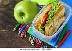 sandwich with cheese and tomato and green apple for a healthy school lunch - stock photo