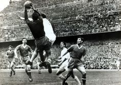 April 1957. European Cup Semi - Final Ist Leg. Real Madrid 3. v Manchester United 1. in the Bernabeu Stadium. Manchester United goalkeeper Ray Wood saves under pressure from Real Madrid's Alfredo Di Stefano