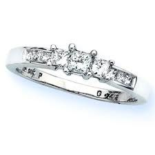 Engagement ring, small and simple. The way it should be. Big diamonds are tacky.