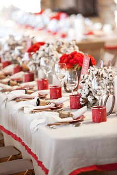 table setting with flowers and cotton blossoms.brass bells,,tin cups...wonderful detail
