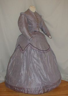 """1860s lilac plaid silk dress, bodice, over skirt & underskirt; bodice lined with cotton, frotn hook & eye closure, decorative buttons, piping at neck, armscyes & waist; both skirts lined with cotton; bust: 32""""; waist: 26""""; under skirt length: 39"""""""